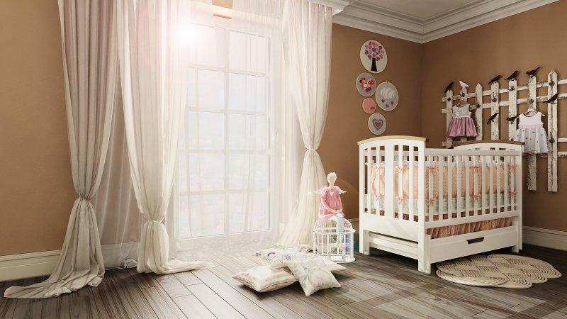 Фото детской маятниковой кроватки